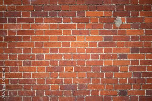 Photo sur Toile Brick wall Muro di mattoni rossi