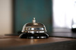 Hotel reception counter desk with service bell.