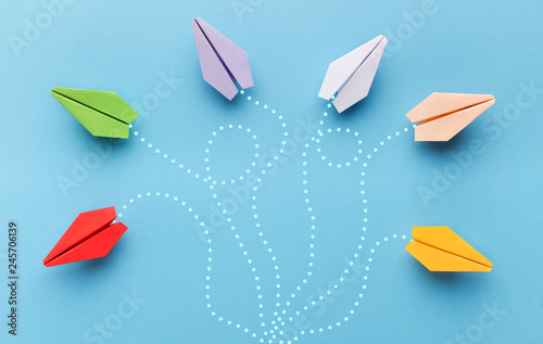 Obraz Paper planes with route trace on blue background - fototapety do salonu