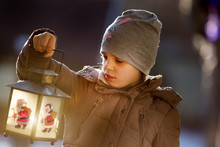 Grl With Lantern On Snow