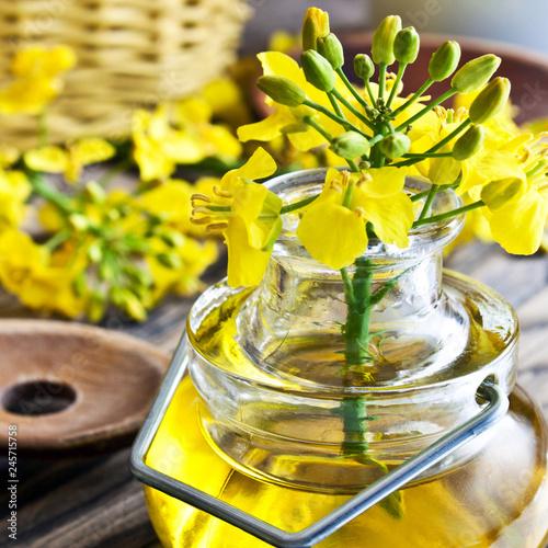 Staande foto Kruiderij Rapeseed oil and blossoms