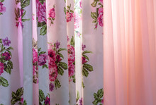 Curtains With Floral Pattern And Tulle On The Living Room Window.