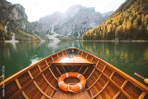 Photo Stands Ship Traditional rowing boat at Lago di Braies in the Dolomites