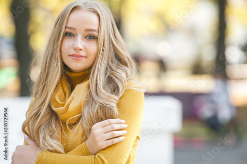 Fototapeta  Closeup portrait of young attractive woman outdoors with copy space