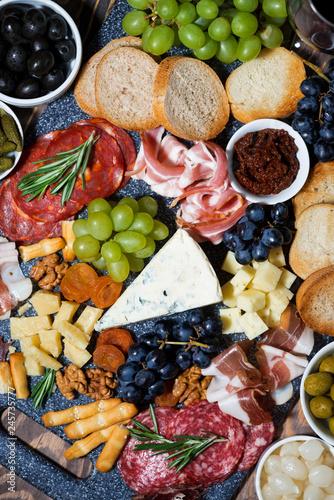 Keuken foto achterwand Assortiment assorted gourmet cheeses and meats, vertical top view