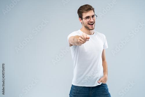 Obraz na plátně Smiling man pointing his finger to you