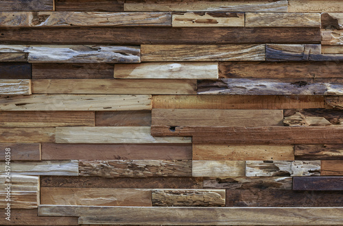 Fotografiet  variation of wooden block pieces stacked as a wall