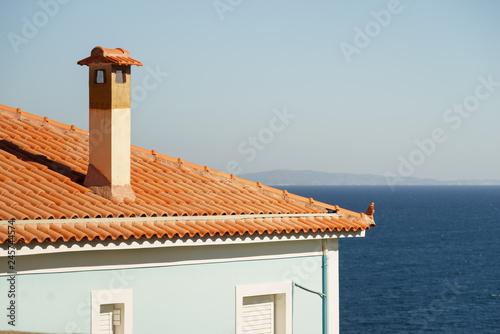 Fotografia Tall chimney on house roof