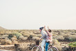 canvas print picture Caucasian aged mature couple have a lot of fun riding together the same bike in outdoor happy leisure activity together in relationship and forever concept - enjoy lifestyle and never end happiness