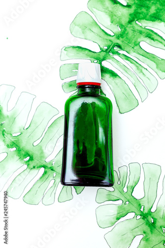 Fotografie, Obraz  Ecological  glass packaging and watercolor leaf monstera