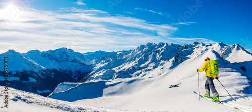 Cuadros en Lienzo Skitouring with amazing view of swiss famous mountains in beautiful winter powder snow of Alps