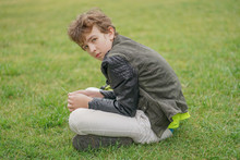Sad Lonely Boy In The Park Sitting Unhappy