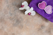 Orchid flower, aroma sea salt, natural cosmetic clay, and towel. Natural skin care. Spa kit for beauty and health. Close up, top view