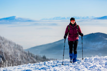 Woman Trekking Traveler With Backpack Hiking In Beskidy Mountains At Sunny Day, Adventure Concept Active Vacations With Outdoor Activity On Snow In The Forest, Poland- Image
