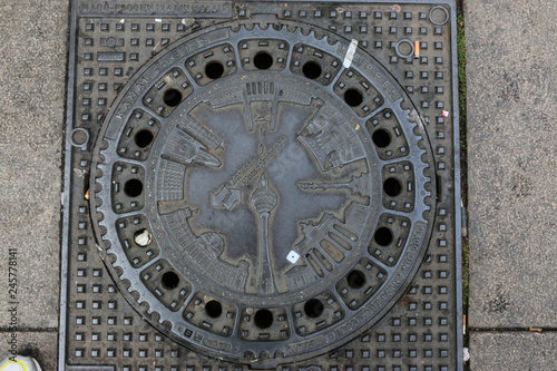 Berliner manhole cover featuring the most popular landmarks of Berlin,