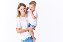 Beautiful Smimling Young Mother With Her Toddler Son (real Family). Isolated On White Background.
