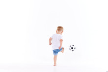 Little Cute Kid Baby Boy 3 Years Old, Football Fan In White T-shirt Playing With Soccer Ball Isolated On White Background.  Lifestyle Concept. Copy Space For Text