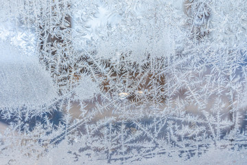 Closeup Photo of Details in Hoarfrost on Window on a Sunny Winter Day - Abstract Background