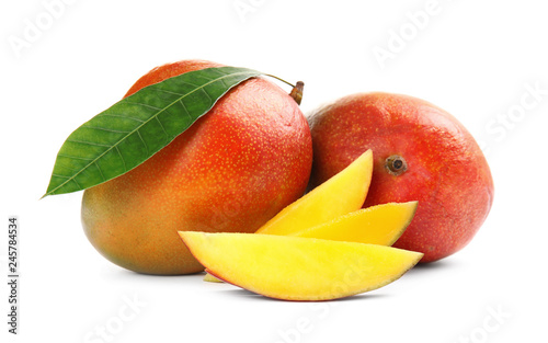 Fototapeta Delicious ripe mangoes on white background. Tropical fruit