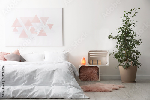 Fotografiet  Light modern room interior with comfortable bed