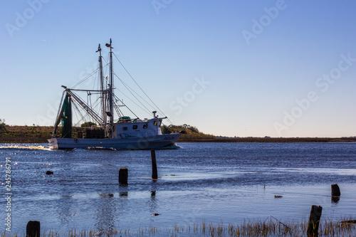 Leinwand Poster Fishing Boat in Intra Coastal waterway