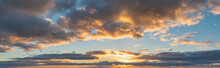 Beautiful Colorful Vibrant Golden Hour Sunset Skyscape With Cloud Formation And Setting Sun