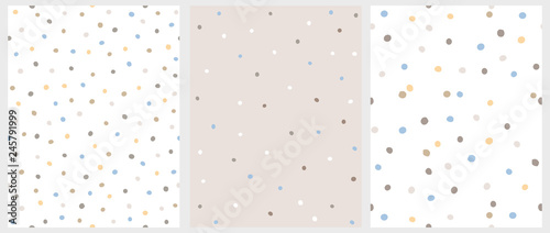 plakat Set of 3 Hand Drawn Irregular Dots Patterns. Blue, Brown and Beige Dots on a White Background. BLue, White and Brown Dots on a Beige Background. Infantile Style Abstract Art. Cute Repeatable Design.