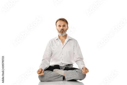 Senior bearded old man practicing yoga classic asana pose isolated on white