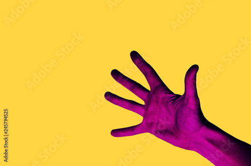 Photo sur Aluminium Pop Art Isolated hand photo on yellow background. Pink hand collage style. Bright pop art template with space for text. Creative minimalistic backdrop. Poster, banner idea. Gestures with fingers