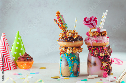 Two freak shakes topping with donut and sweets