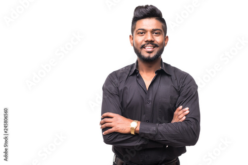 Fototapeta Portrait of happy young indian hipster businessman with crossed hands isolated on white background obraz