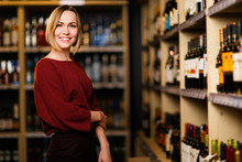 Photo Of Happy Blonde Woman In Store With Wine