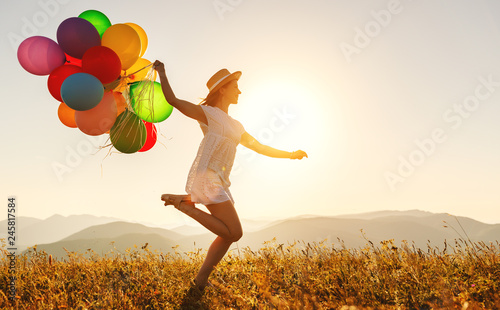 happy woman with balloons at sunset in summer фототапет