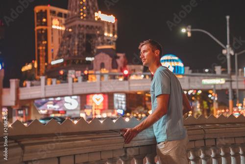 Papiers peints Las Vegas Young man exploring the strip of Las Vegas at night