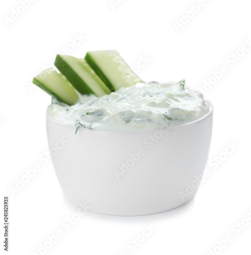 Bowl with cucumber sauce on white background