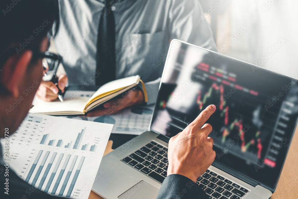 Fototapeta Business Team Investment Entrepreneur Trading discussing and analysis graph stock market trading,stock chart concept