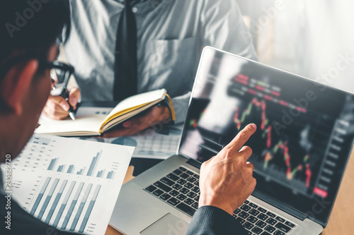 Obraz Business Team Investment Entrepreneur Trading discussing and analysis graph stock market trading,stock chart concept - fototapety do salonu