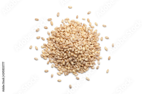 Fotografie, Tablou Pile of peeled barley isolated on white background. Top view.