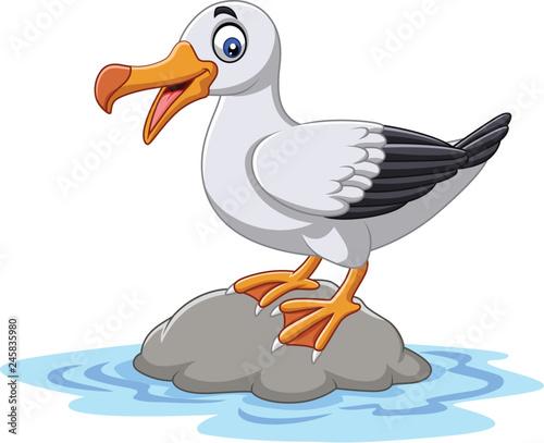Fototapeta premium Kreskówka ładny ptak albatros stojący na skale