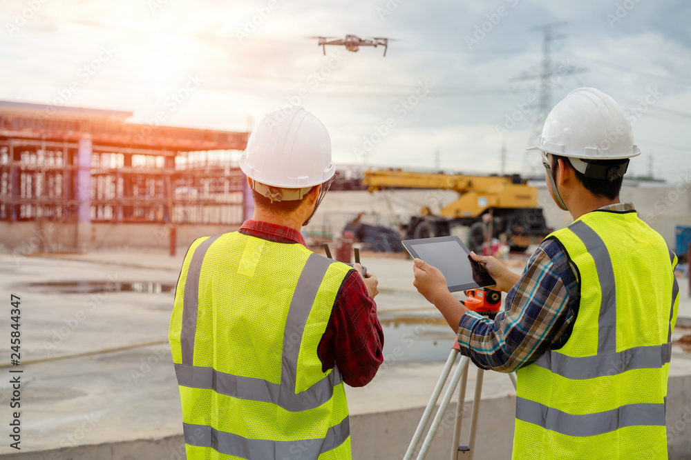 Fototapety, obrazy: Drone operated by construction worker on building site,flying with drone.