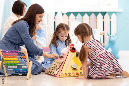 Fotografie, Obraz  Kids play with educational toys in nursery