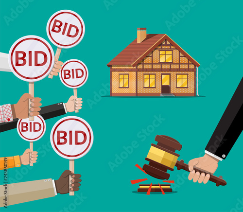 Hands holding auction paddle. Real estate house Canvas Print