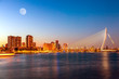 Leinwanddruck Bild Erasmus bridge over the river Meuse with skyscrapers and moon in Rotterdam, South Holland, Netherlands during twilight sunset. Rotterdam panorama