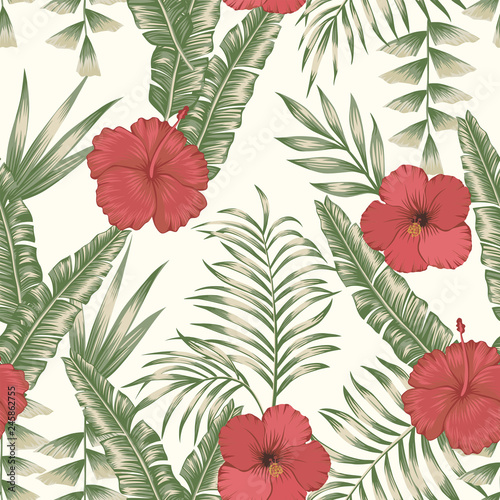 Tropical leaves and flowers seamless beige background