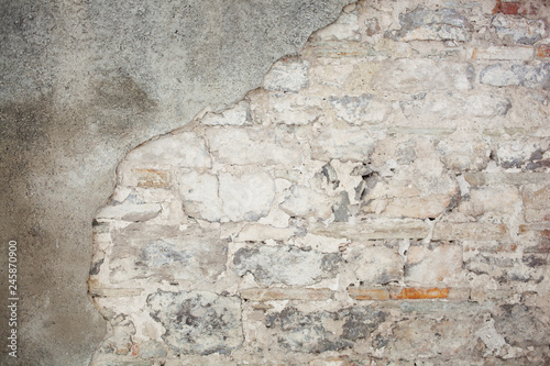Deurstickers Oude vuile getextureerde muur old medieval plaster and brick wall in shadow