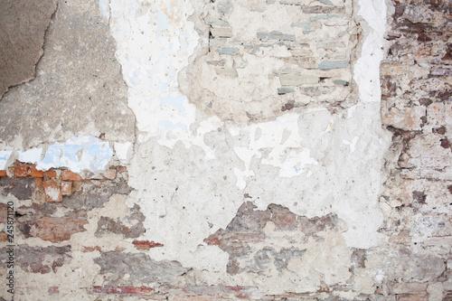 Foto auf AluDibond Alte schmutzig texturierte wand old medieval plaster and brick wall in shadow