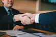 Business people accept or confirm project on the proposal and join shaking hands at office.