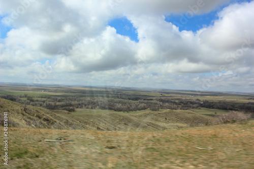 Spoed Foto op Canvas Blauwe hemel blue sky and clouds over prarie