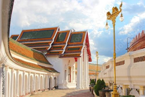 Beautiful landscape in Phra Prathom Jedi (Golden Pagoda) at Nakonpratom province with the clear blue sky Wallpaper Mural
