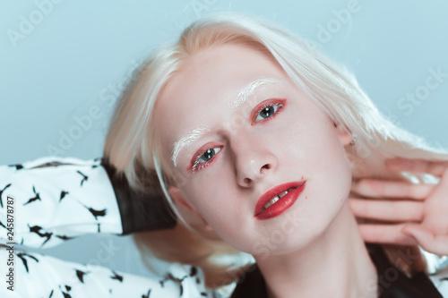 Fotografie, Obraz  portrait of blonde albino girl in studio